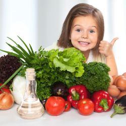 Kid loving her veggies
